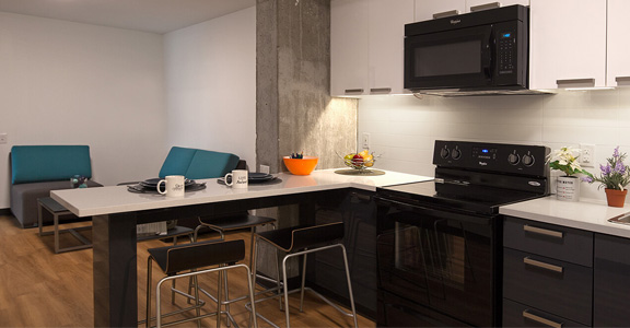 Kitchen and common area in Centennial Place suite